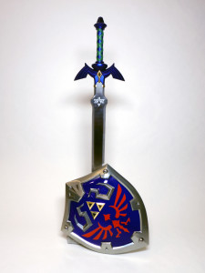 A photo of the Master Sword and Hylian Shield.